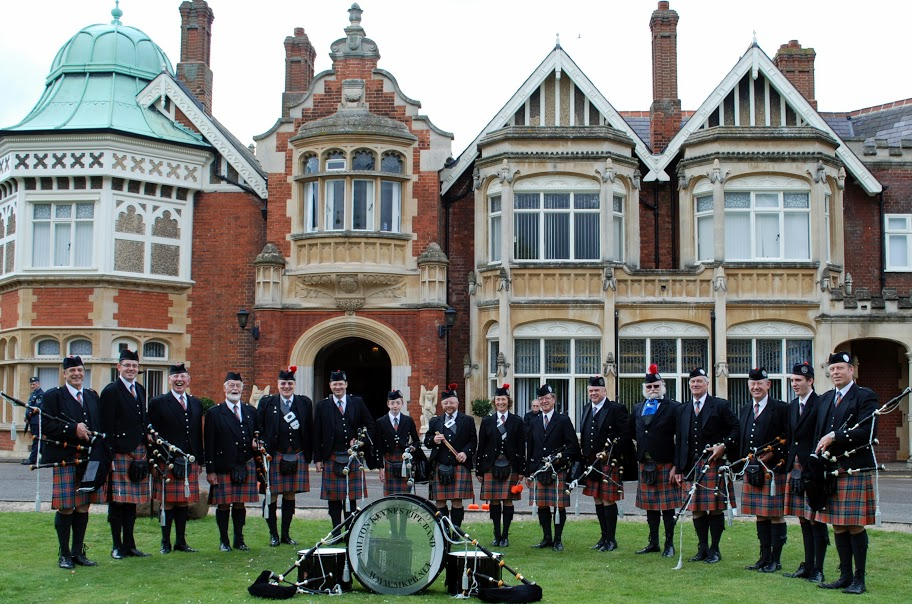 Milton Keynes Pipe Band stadiing in front of the house at Bletchley Park.